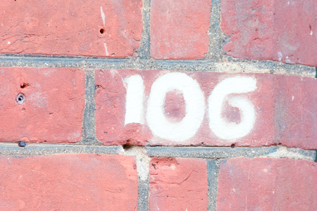 inform information: House number 106 painted sign