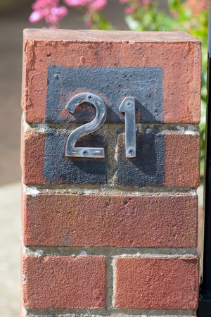 21: House number 21 sign Stock Photo