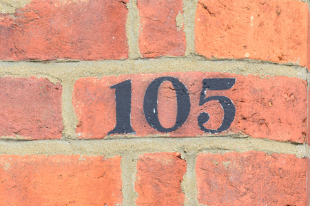 inform information: House number 105 painted sign
