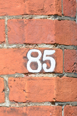 inform information: House number 85 painted sign