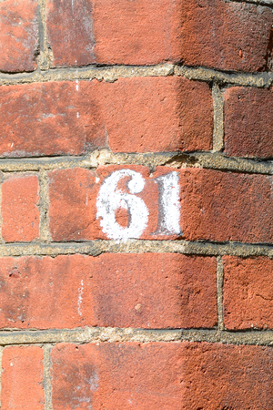 inform information: House number 61 painted sign