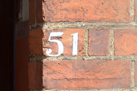 inform information: House number 51 painted sign