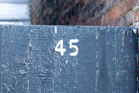inform information: House number 45 painted sign on gate