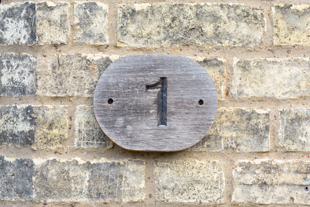 inform information: House number 1 wooden sign Stock Photo