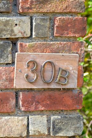 inform information: House number 30B sign