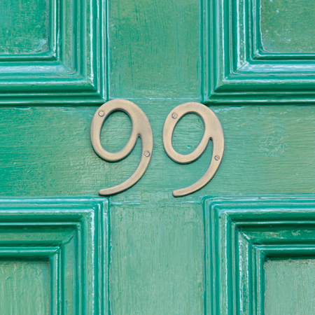 99: House number 99 sign on door