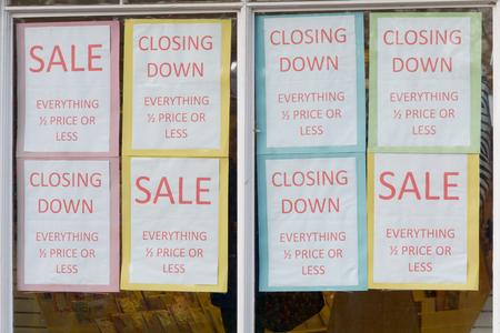 shop window: Closing down sale signs in shop window Stock Photo