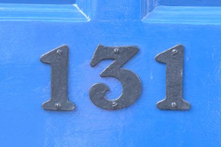 inform information: House number 131 sign