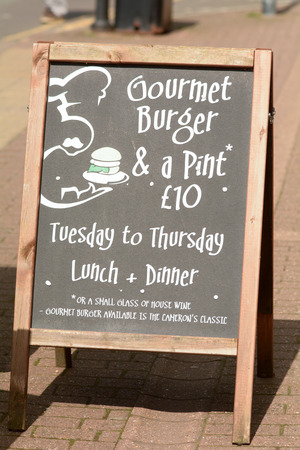 pint: Gourmet Burger and pint for £10 sign outside pub