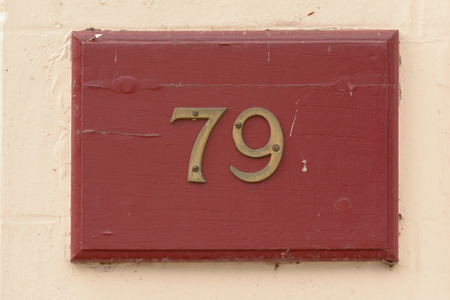 inform information: House number 79 sign Stock Photo