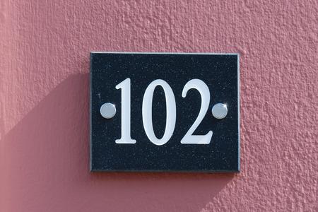 inform information: House number 102 sign
