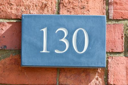 inform information: House number 130 sign