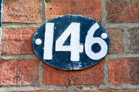 inform information: House number 146 sign