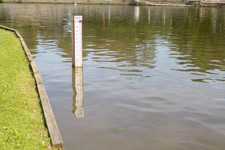 depth measurement: Water depth marker in river