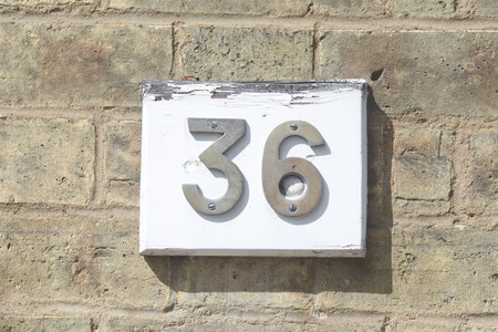 number 36: House number 36 sign on wall Stock Photo