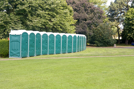 Row of portable toilets at festival