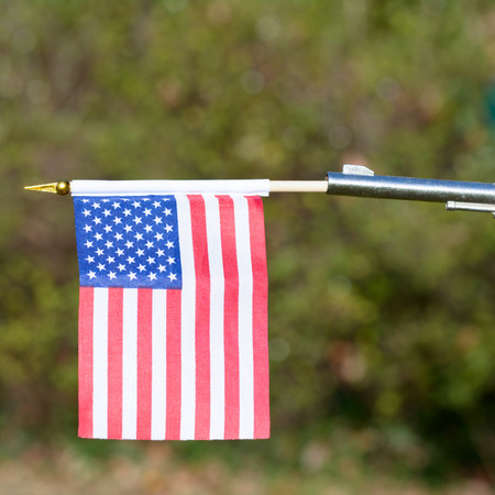 US Flag emerging from gun barrel - comment on US gun control Stock Photo