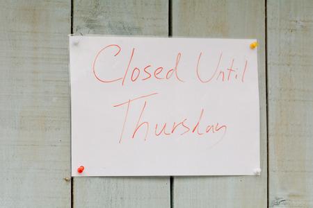 thursday: Closed Until Thursday sign outside shop