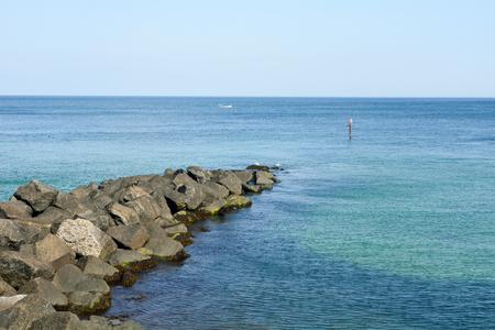 man made: Man made rock sea wall Stock Photo
