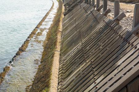 damaged: Damaged wooden sea defences