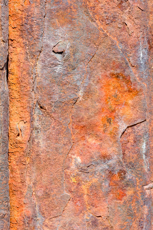 Rusty eroded metal sea defence wall Imagens