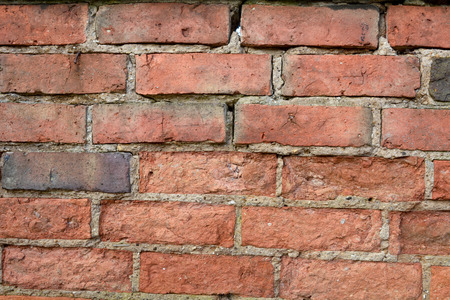 damaged: Wall with damaged bricks