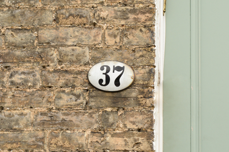 inform information: House number 37 sign on wall