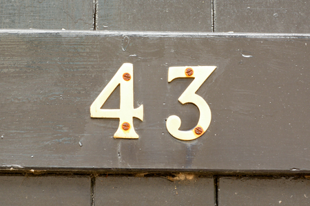 House number 43 sign on gate Stock Photo