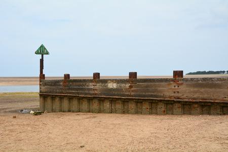 groyne: Groyne sea defences on beach