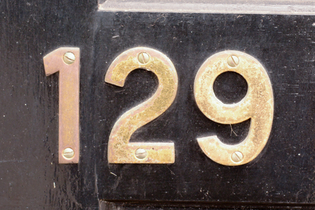 House number 129 sign Stock Photo