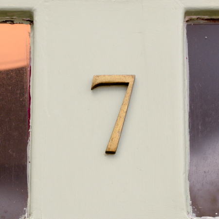 House number 7 sign on wooden door