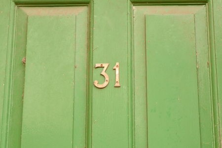 House number 31 sign on door Stock Photo