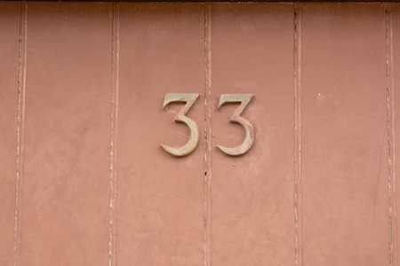 House number 33 sign on door Stock Photo