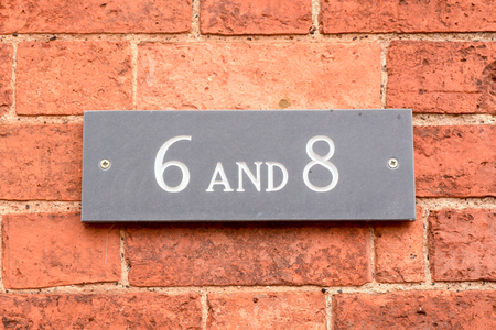 House number 6 & 8 sign on wall