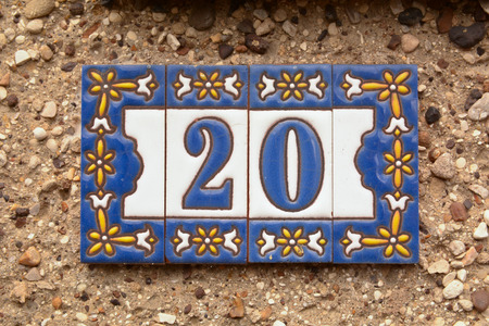 House number 20 sign on wall