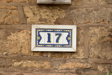 House number 17 sign on wall