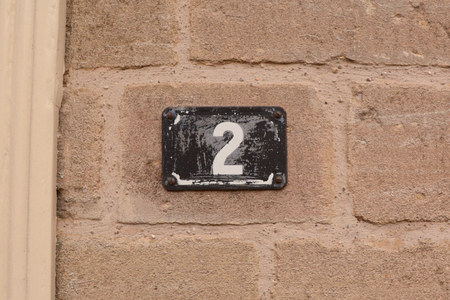 House number 2 sign on wall Stock Photo