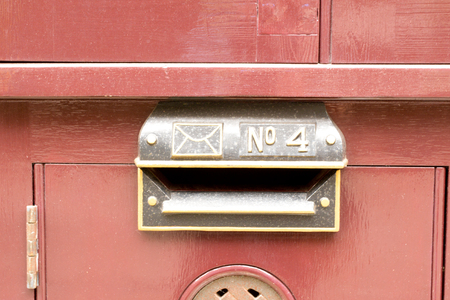 House number 4 sign on letterbox