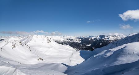 deep powder snow: Snowy Alps with blue sky