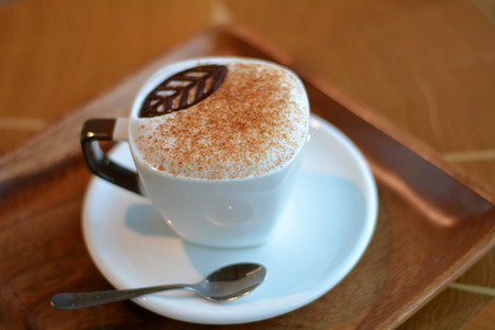 foamy: Delicious foamy cappuccino on the wooden table