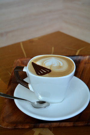 foamy: Delicious foamy cappuccino on a wooden table