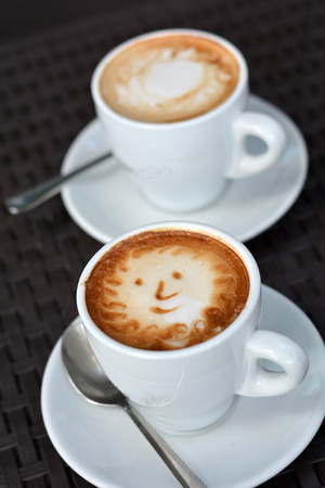 foamy: Cup Of Foamy Cappuccino With Smile On A Black Background