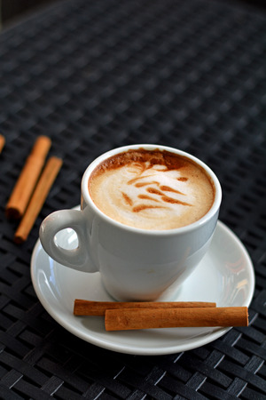 foamy: Cup of delicious foamy cappuccino on the black background Stock Photo