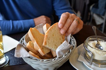 ciabatta: Italian ciabatta on a basket on a restaurant table
