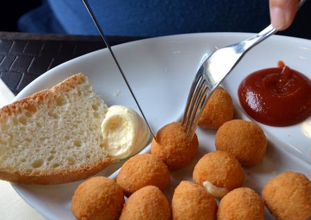 breaded: Breaded mozzarella cheese balls.Arancine.Italian food.