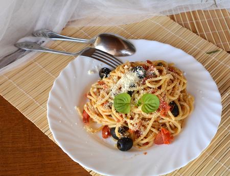 Spaghetti a la puttanesca on a bowl. Italian food.