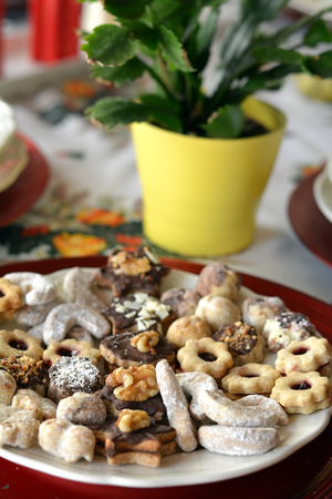 bisquit: Christmas cookies with chocolate,nuts and coconut decorated on a plate on a table Stock Photo