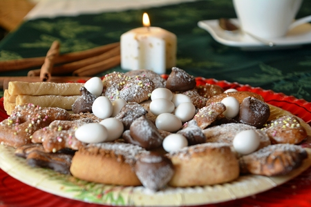 lighted: Lovely close up image of Christmas cookies decorated on a table with lighted candle Stock Photo