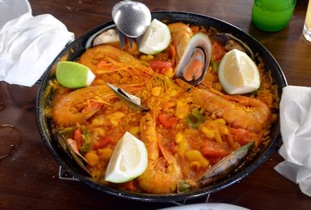 Fresh Paella served on a casserole. Traditional Spanish cuisine. Stok Fotoğraf