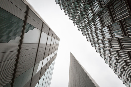 capturing: A photo looking up capturing three different buildings on an angle
